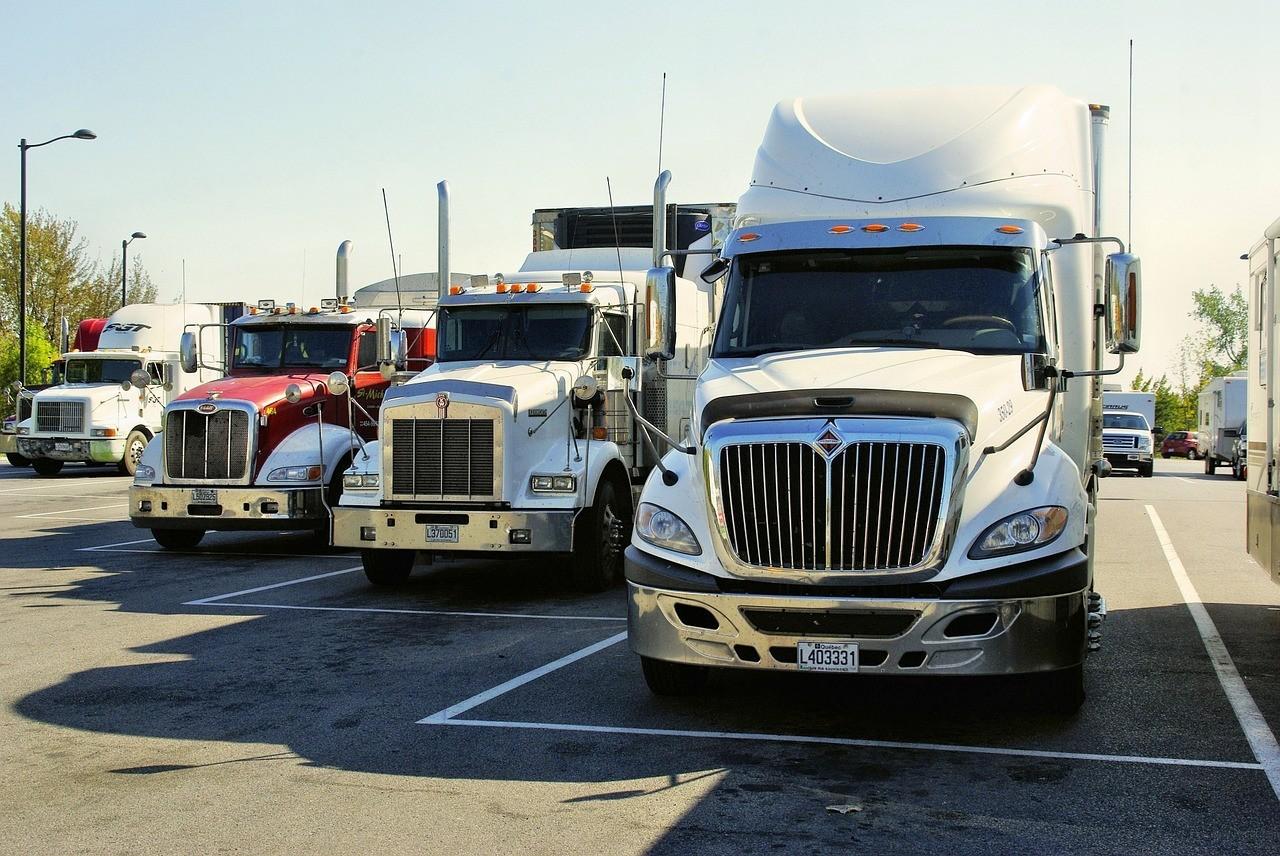 Semi-trucks parked in a parking lot.