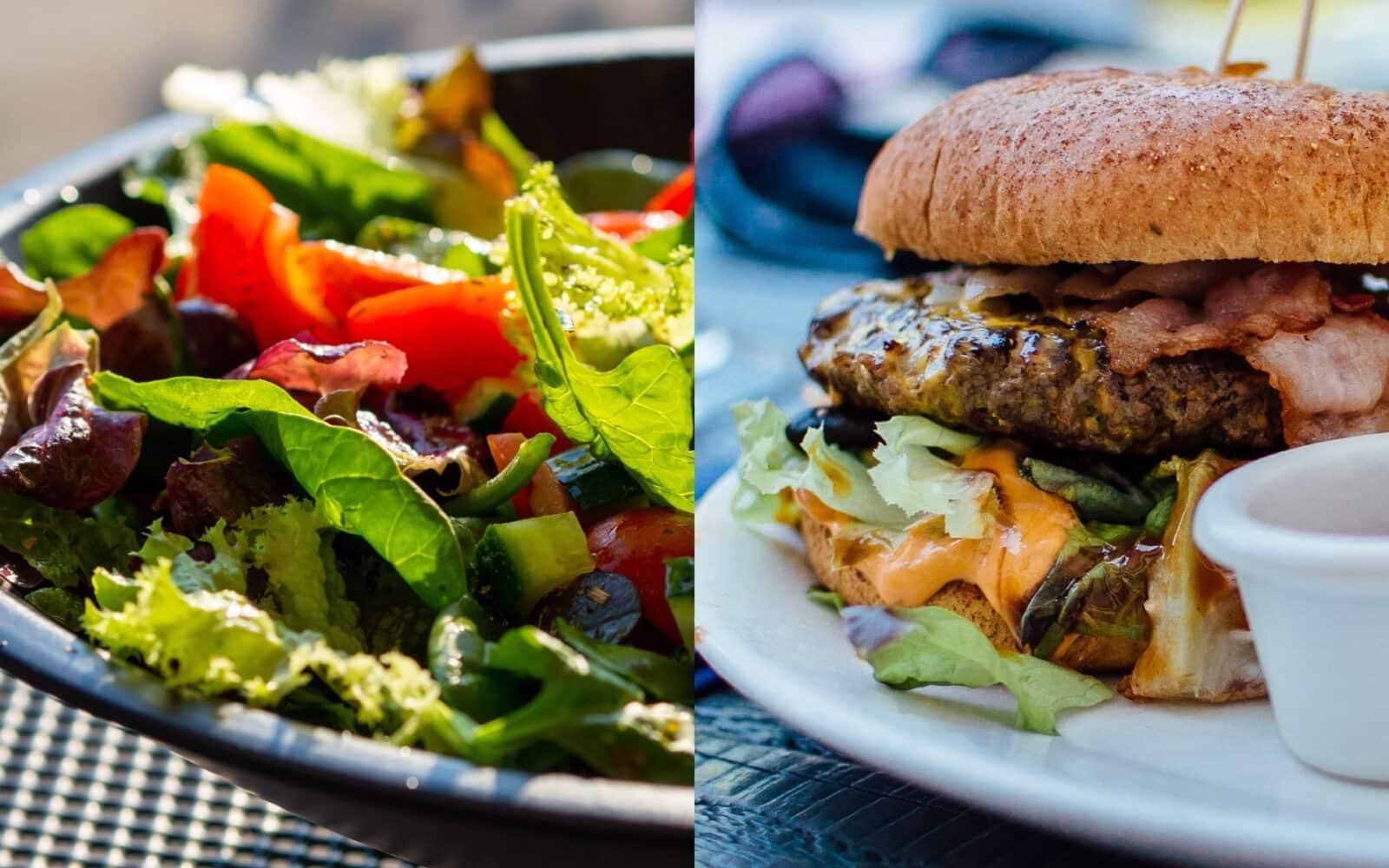 A loaded cheeseburger next to a healthy salad.